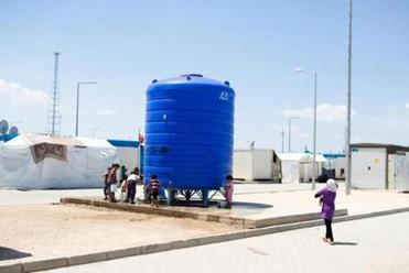 A drinking water tank in the refugee camp nicknamed Container City in Oncupinar, Turkey.
